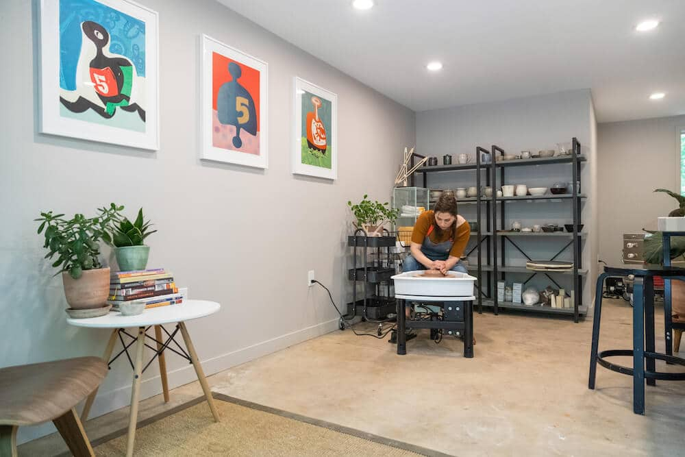 Naturally lit, Grey Ceramic Art Studio with a poured concrete flooring in a Garage.