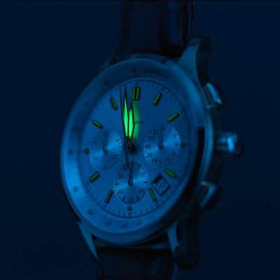 A wrist watch with a glowing minute hand.